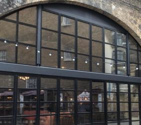 Aluminium bifold doors and windows in a custom frame fitted at a restaurant in London