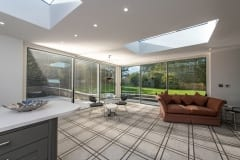 Luxury Home Extension with Large Glass Doors and Roof